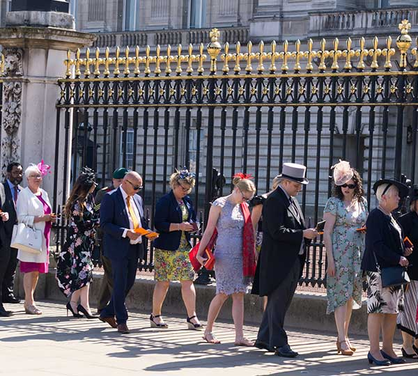Guests arriving for the Queen's Garden Party at Buckingham Palace